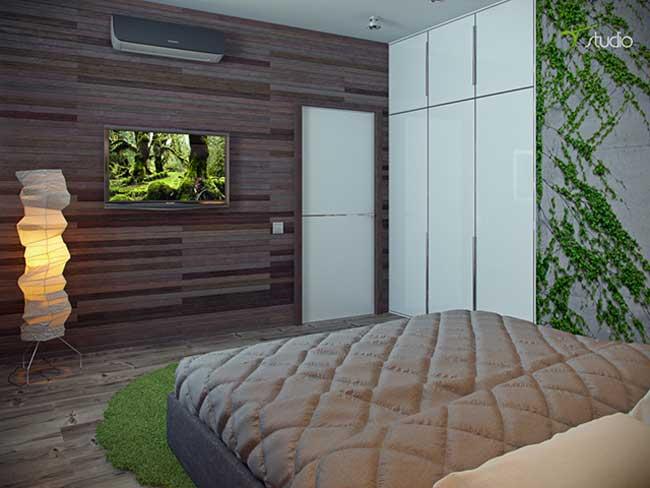 Интерьер спальни в экостиле. Стены отделаны деревянными панелями со встроенным шкафом