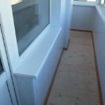 Обшивка балкона пвх панелями. Фото