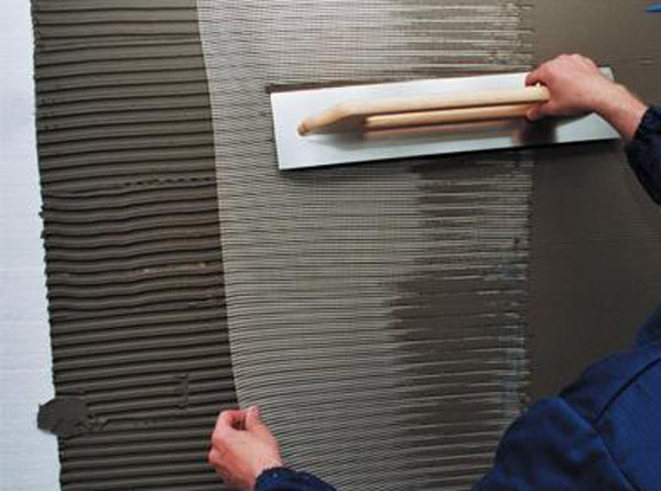 Наклеивание штукатурной сетки на пенопласт. Фото