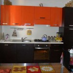 Кухня сверху оранжевый, снизу венге. Фото 12