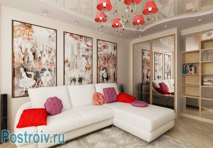 Угловой диван в интерьере гостиной с модульными картинами