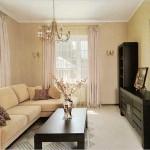 Угловой диван размещенный у стены в гостиной