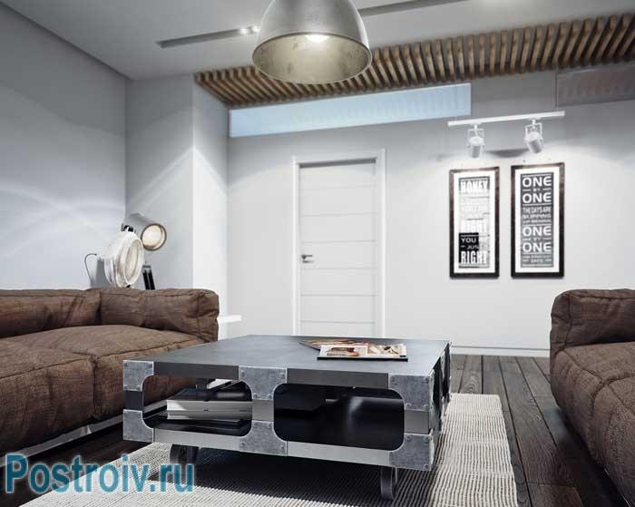Дизайн журнального столика в гостиной в стиле лофт. Фото