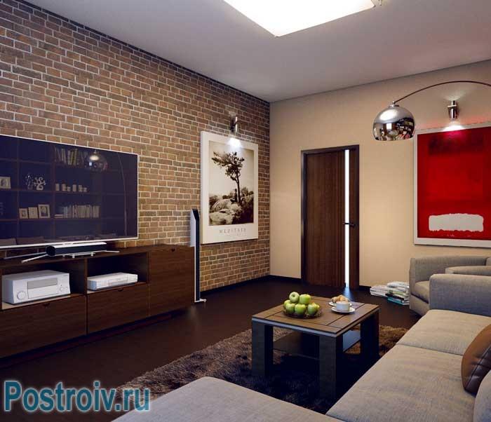 Кирпичная стена в интерьере гостиной. Фото