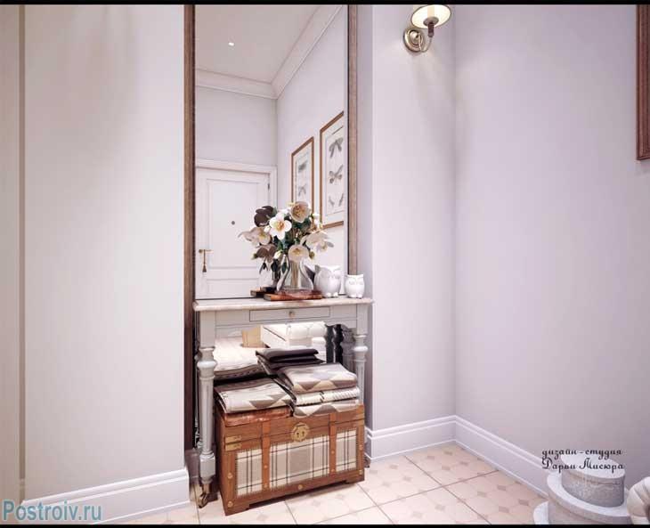 Красивая плитка на полу в коридоре. Бра возле большого зеркала. Фото интерьера однокомнатной квартиры