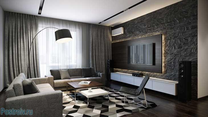 Черный, белый и серый цвета на ковре в интерьере гостиной. Фото