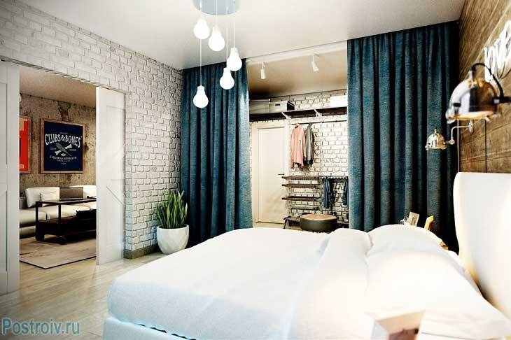 Интерьер белой спальни. Белый кирпич на стенах. Фото