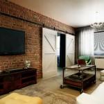 Интерьер 3-комнатной квартиры. Гостиная в стиле лофт. Кирпичная стена и двери купе. Фото