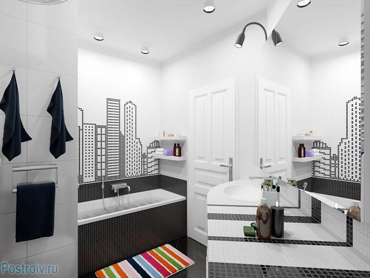Черно-белая ванная комната с ярким ковриком. Фото
