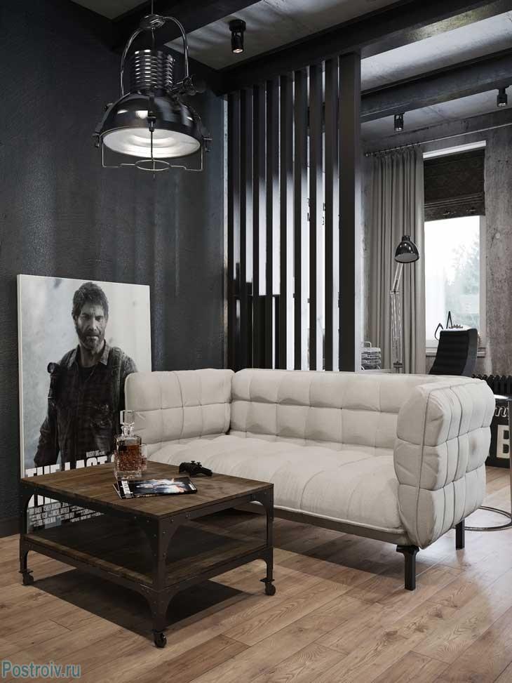Белый диван в черном интерьере комнаты. Фото
