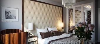 Дизайн интерьера небольшой спальни. Серые стены и подушки шоколадного цвета
