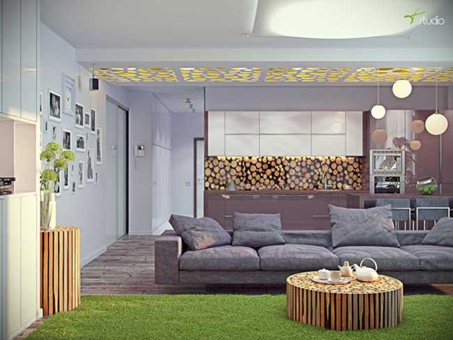 Гостиная совмещенная с кухней в светлых тонах с большим диваном