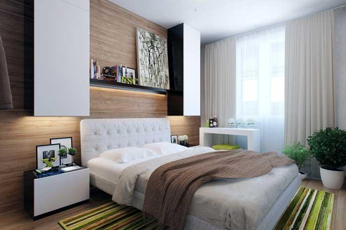 Дизайн современной спальни. Навесные шкафчики. Зеленый ковер