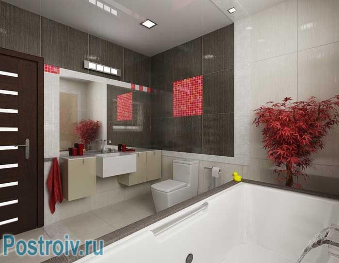 Интерьер ванной комнаты с красными предметами декора
