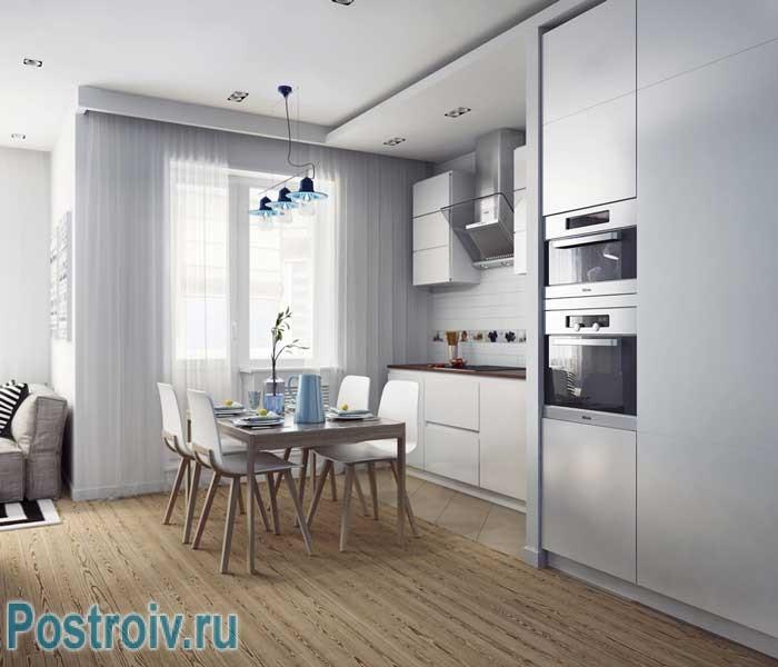 Белая кухня со встроенной техникой. Фото