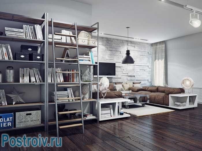 Большой коричневый диван в гостиной. Современный книжный стеллаж