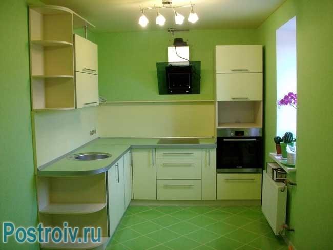 Стены кухни зеленого цвета. Фото