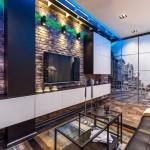 Декорирование кирпичной кладкой стен в гостиной в стиле лофт - Фото