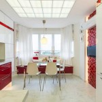 Кухня белого цвета с красным декором. Фото