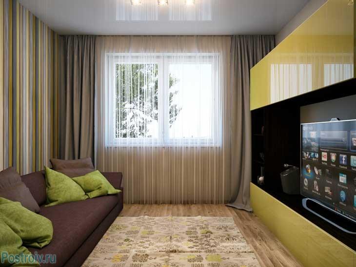 Приятный ковер в небольшой гостиной. Фото