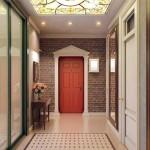 Красная входная дверь. Декоративный кирпич и бежевый глянцевый пол. Фото