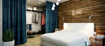 Спальня в стиле лофт. Дерево на стене. Синие шторы. Фото