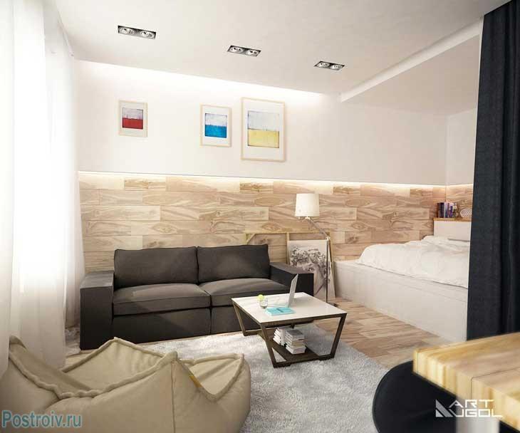 Современный интерьер однокомнатной квартиры с нишей для кровати. Фото