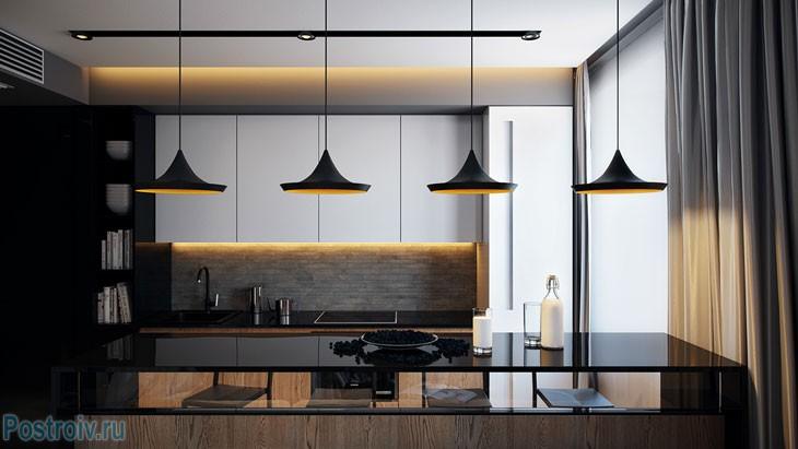 Черные современные светильники над барной стойкой. Фото
