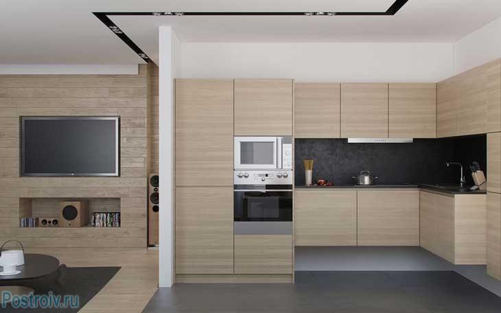 Кухонная зона светлых оттенков бежевого. Фото