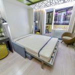 Интерьер совмещения спальни и гостиной в одной комнате