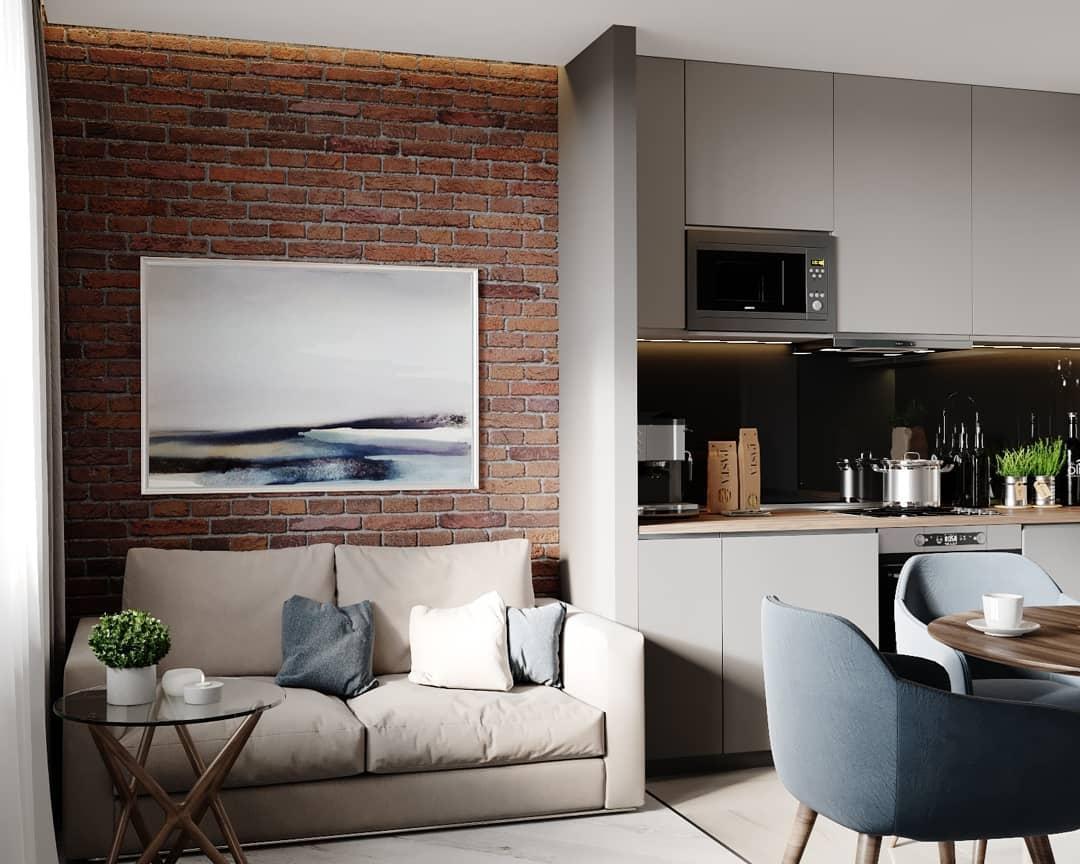 На фото зона гостиной на кухне в интерьере квартиры 30 кв. м.