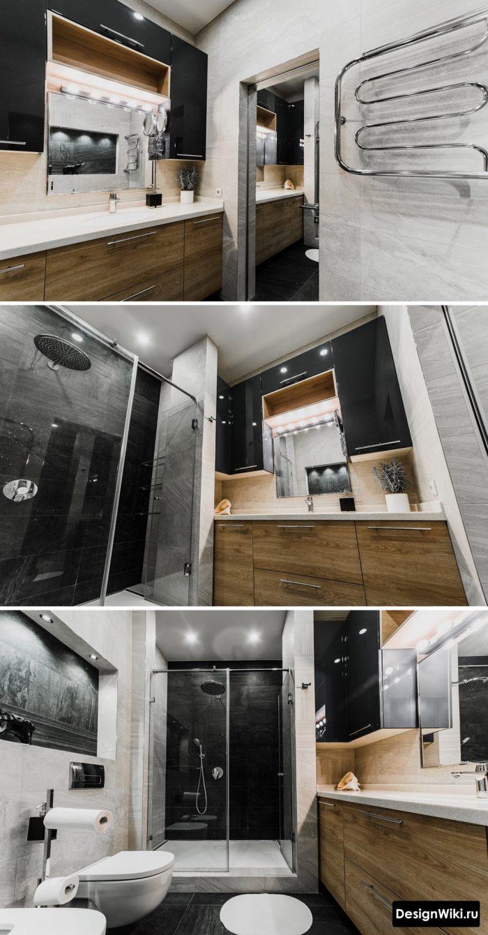 Черные шкафы рядом с зеркалом в современной ванной комнате